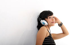 Music and headphones. Portrait of woman smiling listening music on headphones Stock Images