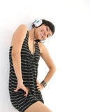 Music and headphones. Portrait of woman smiling listening music on headphones Royalty Free Stock Photo