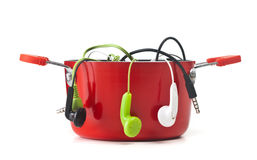 Music headphones in red pot Royalty Free Stock Photo