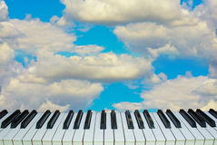 Music heaven piano keys against the sky Royalty Free Stock Images
