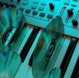 Music home studio (cyan 2). Synthesizer & CD. Camera: Nikon D50, silver reflector (30 inches) &...color stock image