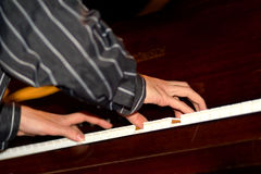 Music I. Arms of the musician playing on the piano Stock Photo