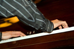 Music II. Arms of the musician playing on the piano Royalty Free Stock Photo