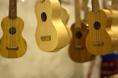 Wooden instruments and tunes hanging from a wire in construction. Music and imagination to accompany you along the entire length Royalty Free Stock Photos