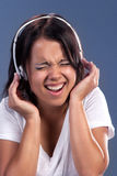 Music inside. Pretty girl listening to the music in headphones Royalty Free Stock Photography