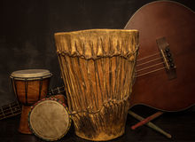 Music instruments -Djembe drums and acoustic bass guitar. Old music instruments -Djembe drums and acoustic bass guitar Stock Photos