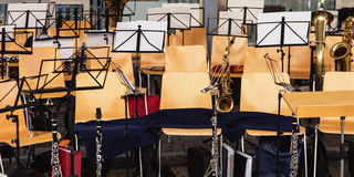 Music instruments, music stands and chairs, traditional music so Stock Photography