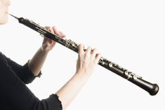Music instruments - oboe hands Stock Photos