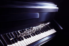 Music instruments oboe with piano Stock Photos