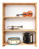 Music instruments in shelf Stock Image
