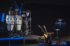 Music instruments on stage in dark studio Royalty Free Stock Photography