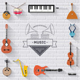Music instruments on white modern brick wall concept. Icons design for your product or design, web and mobile Royalty Free Stock Photography