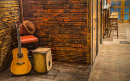 Music instruments on wooden stage. In pub Stock Photos