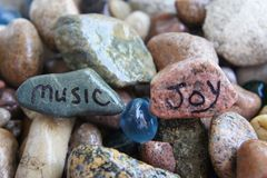 Music and Joy Written on River Rocks Royalty Free Stock Photo