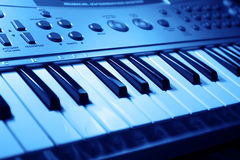 Music keyboard. Music instrument keyboard in blue mood Royalty Free Stock Photos