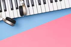 Music keyboard headphone on blue pink copy space for Music poster concept. Music keyboard synthesizer headphone on blue pink copy space for Music poster concept stock photography