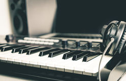 Music keyboard with headphone and DAW computer studio. Set up stock photography
