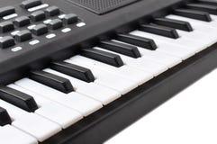 Music keyboard keys. Close-up of music keyboard keys. close frontal view royalty free stock photo