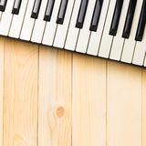 Music Keyboard keys on wooden table square copy space. Music Keyboard keys on wooden table square with copy space royalty free stock photography