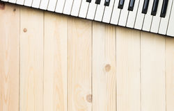 Music Keyboard keys on wooden table. Square with copy space stock photo