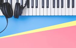 Music keyboard synthesizer on blue copy space for Music poster concept. Music keyboard synthesizer instrument on blue copy space for Music poster concept stock photography