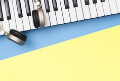 Music keyboard on blue yellow copy space. Music keyboard synthesizer on blue yellow copy space stock photos