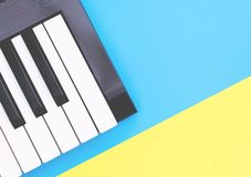 Music keyboard instrument on blue yellow copy space for Music poster concept. Music keyboard synthesizer instrument on blue yellow copy space for Music poster stock image