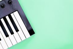 Music keyboard instrument on teal copy space for Music poster concept. Music keyboard synthesizer instrument on teal copy space for Music poster concept royalty free stock photo