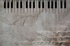 Music keys and notes. Grunge paper with music notes and piano keys royalty free stock image