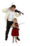 Music Lesson. Beautiful six year old girl plays violin and frustrates man in tuxedo Stock Photo