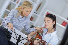 Music lesson in conservatory Stock Photo