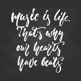 Music is life. That`s why our hearts have beats - hand drawn Musical lettering phrase isolated on the black chalkboard. Background. Fun brush chalk vector quote stock illustration