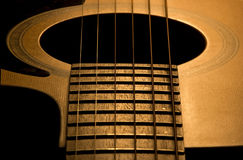 Music lines 2. A detail of an accoustic western guitar Stock Image