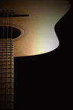 Music lines. A half of a country guitar Royalty Free Stock Image