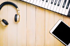 Music listening equipment on wood Royalty Free Stock Images