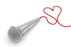 Music for love. Concept image with microphone and heart shaped wire Stock Photography