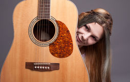 Music love. Young hippie lady loves her guitar and smiling Stock Photo