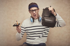 Music lover. Excited young man enjoying music in his cassette player stock photos