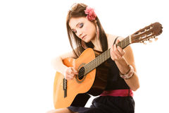 Music lover, summer girl with guitar isolated. Travel vacation concept. Music lover summer girl playing acoustic guitar isolated on white background Stock Photo