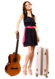 Music lover, summer girl with guitar and suitcase Stock Image
