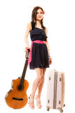 Music lover, summer girl with guitar and suitcase Royalty Free Stock Photos