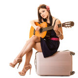 Music lover, summer girl with guitar and suitcase Royalty Free Stock Photo