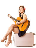 Music lover, summer girl with guitar and suitcase Stock Photography