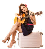 Music lover, summer girl with guitar and suitcase Stock Photos