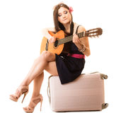 Music lover, summer girl with guitar and suitcase Royalty Free Stock Photography