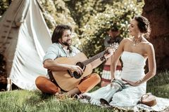 Cheerful young man and woman singing songs