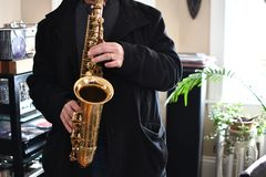 Senior man play saxophone royalty free stock photos