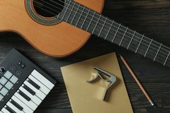 Music maker composition on wooden background stock photography