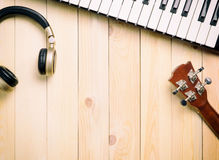 Music making instrument on wood. En surface Royalty Free Stock Photos