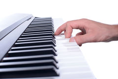 Music. Male hands playing digital piano. Isolated over white background Stock Photo